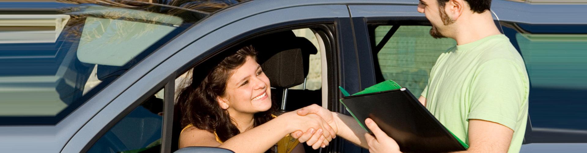 Woman passing driving exam